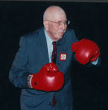 Wallace donned boxing gloves and coached his sales force on his personal 'Rule of a Good Salesman'.